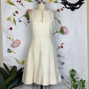 Akris Punto sleeveless cream pleated dress